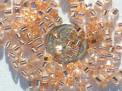 10 grams Toho Triangle Seed Beads - 8/0 - #31 - Silver-Lined Rosaline