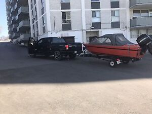 Red and black boat 4.27 m
