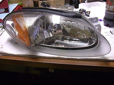 NOS OEM 1998-2003 Ford Escort Right Side Headlight Part #F8CZ-13008-AA (1998 Ford Escort Headlights)