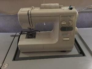 Janome sewing  machine  and cabinet Oakville Hawkesbury Area Preview