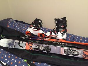 Salomon Skis, boots, poles and bag