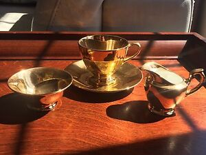 Gold porcelain cup Saucer and sugar & cream
