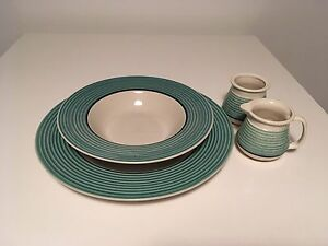 Two serving plates and cream &sugar containers