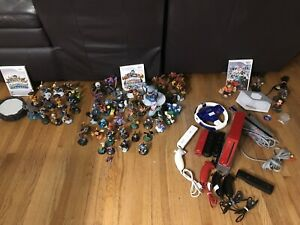 Wii console, games, and figures (Skylanders / Disney Infinity)