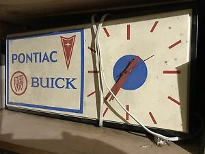Old dealership clock garage art