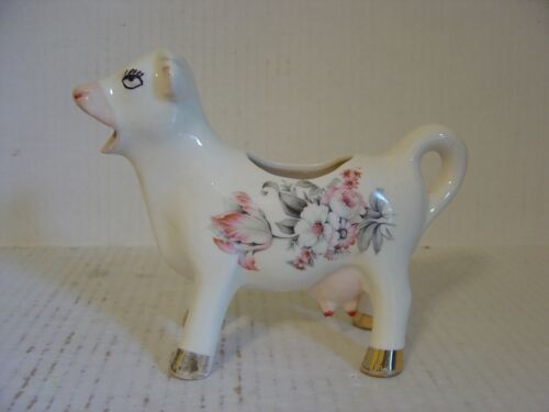 VINTAGE COW CREAMER PITCHER WITH FLOWERS ON SIDE