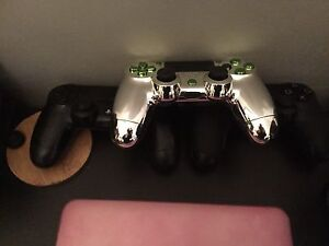 PS4 controller, 1 original, 1 chrome/green, 1 gripped & toggle London Ontario image 2