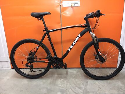 DUAL DISK FLUID MOUNTAIN BIKE IN GOOD CONDITION