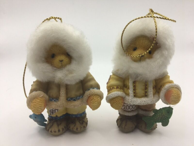 Set of 2 Cherished Teddies Eskimos with fish ornaments dated 1999 and 2000.