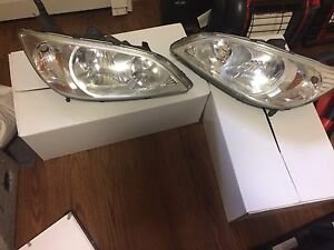 Stock headlights in the box. For 05 civic