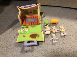 Toy rabbit house with four bunnies and furniture