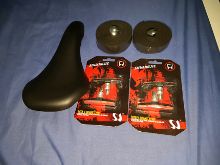 Brand new  bicycle seat+2 sets break pads and handle bar wrap