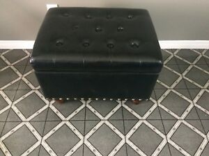 Black leather look ottoman