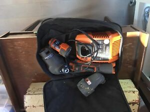 Rigid battery charger palm nailer oscillating tool