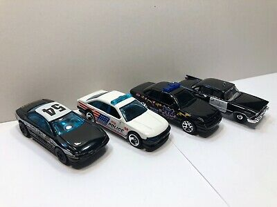 Hot Wheels Lot of 4 Police Cars (Olds Aurora, Crown Victoria, 59 Dodge, Cruiser