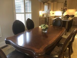 Dining/kitchen table with eight chairs
