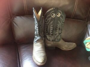 Black and grey used cowboy boots