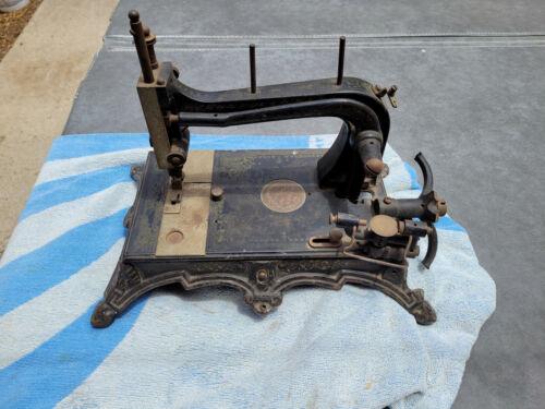 Antique Civil War Era Sewing Machine, works but needs a new hand wheel.