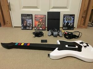 PS2 w/ 1 Controllers, 3 Games, and 1 Rockband Guitar