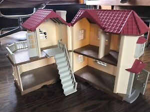 Doll House - folding with extensive playmobil figurines