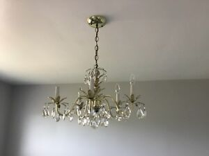 Brass chandelier with glass crystals  $95.