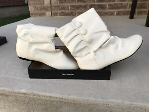 Women's boots. Cream coloured. Never used