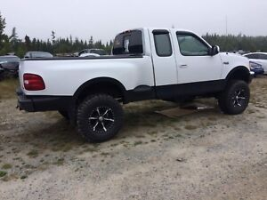 Trade 97 step side f150 lifted