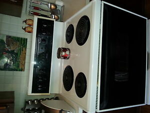 frigidaire self clean stove with coil top.