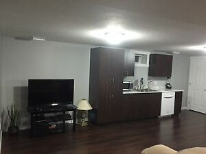 2 BED FULLY FURNISHED BASEMENT SUITE UTILITIES INC