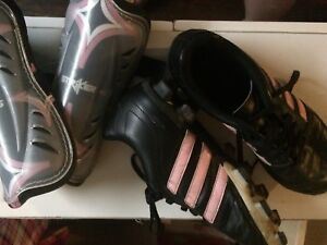 Soccer cleats (pink stripe) and shin guards size 4 1/2