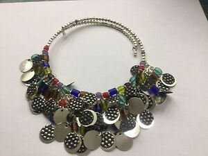 Silver circle and bead choker spring loaded