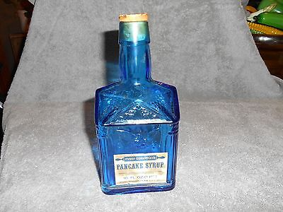 VTG. PAUL REVERE BLUE GLASS SYRUP BOTTLE WITH MARY WHEATON'S LABEL