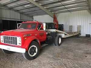 1972 GMC 427 truck with flat bed trailer