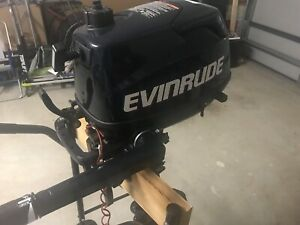 Evinrude 4hp 4 stroke motor and stand