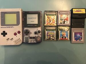Two Nintendo Game Boys plus assorted games