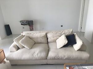 Two Cream fabric plush sofas foot rest Cooks Hill Newcastle Area Preview