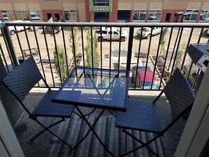 patio table with 2 chairs.