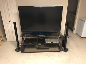 """55"""" LCD, TV stand and Surround sound system"""