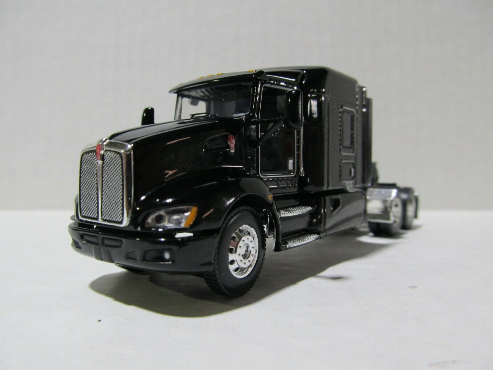 DCP / FIRST GEAR 1/64 SCALE T-660 KENWORTH, MIDROOF SLEEPER,  BLACK, GRAY ENGINE