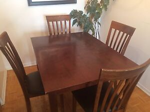 A complete set of dining table with 4 chairs