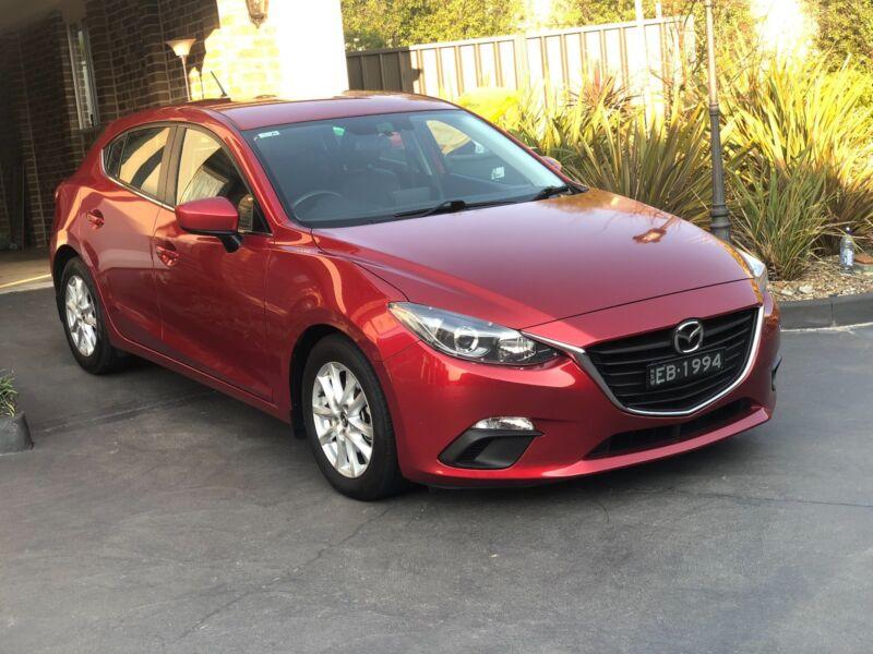 2014 Mazda Mazda3 Hatchback Orange Orange Area Image 2. 1 Of 10