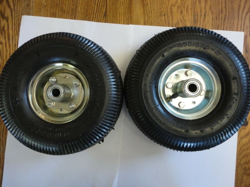 """two 10"""" inflatable rubber wheels 4.10/3.50-4 on steel rims, 5/8"""" axle diameter"""