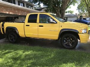 Solar yellow 2005 Dodge Ram 1500 Quad Cab 4X4 Laramie