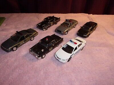 ( 6 ) 1/43 scale diecast police cars, all are different makes, models.