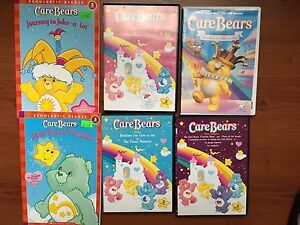 Care Bear DVD's and book lot