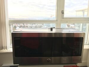 Large GE Microwave (less than 1 year old)