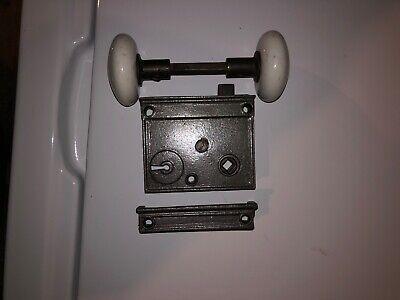 Refurbished cast iron rim locks with porcelain door knobs