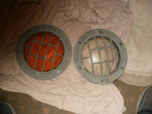 TWO BRASS LOOK ALIKE PORT HOLES ONE YELLOW & ONE CLEAR GLASS