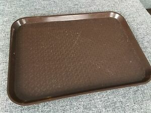 Brown plastic cafeteria trays