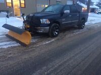 Snow plowing , salting and sanding